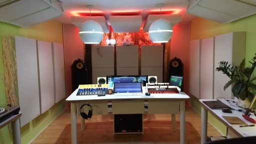 Tuned membrane bass traps and cloud panels by GIK Acoustics in Da Goose Music Studio front shot red lighting