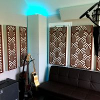 Home recording studio ideas with GIK Acoustics Impression series acoustic panels and white soffit bass traps and couch